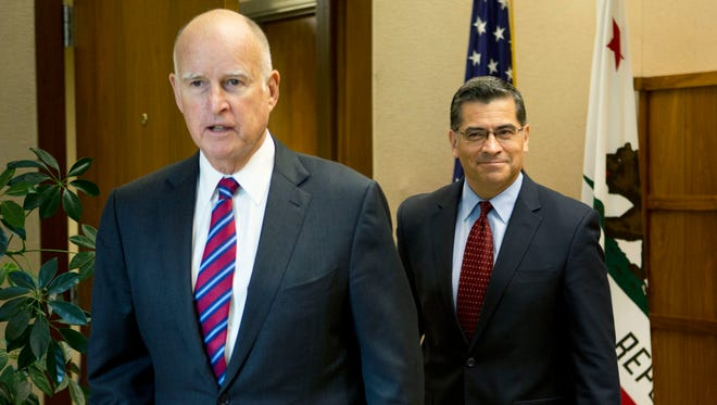 California Gov. Jerry Brown with the state's attorney general, Xavier Becerra.