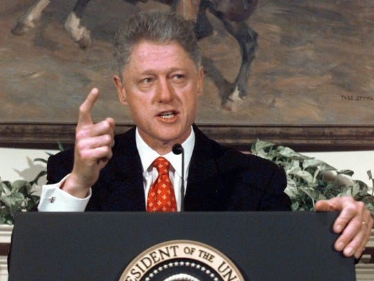 President Bill Clinton angrily shakes his finger as