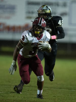 Stanhope's Bennie Smith Jr. runs downfield during the game on Friday, Oct. 2, 2015, in Wetumpka, Ala. Wetumpka defeated Stanhope-Elmore 14-13 after a failed two point conversion.