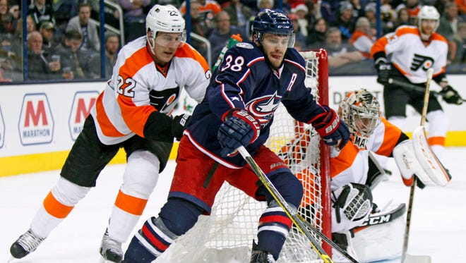 Luke Schenn, left, and the Flyers rallied from a two-goal deficit to take the Columbus Blue Jackets to a shootout.