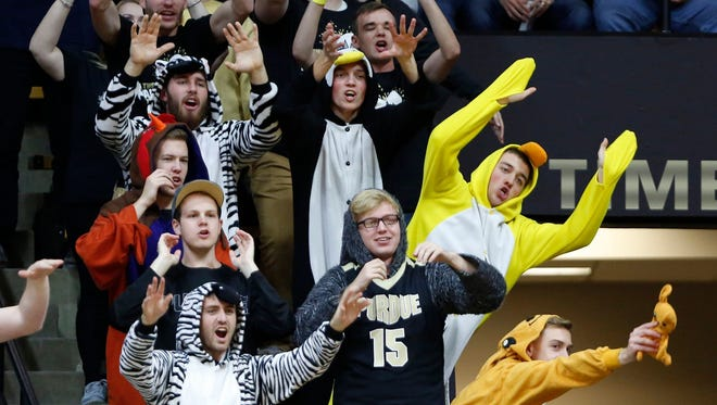 Paint Crew loyalists try to distract a player shooting a free throw.