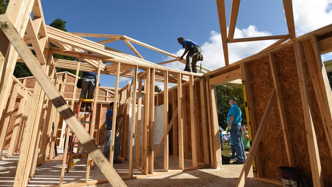 Volunteers for Habitat for Humanity recently descended on Mead Street in Zanesville for a blitz build, building a home in less than a week.
