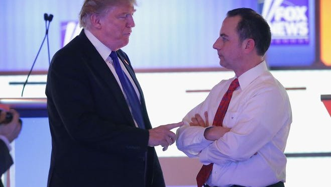 Republican presidential candidate Donald Trump (left) speaks with Reince Priebus, chairman of the Republican National Committee, at a debate sponsored by Fox News in Detroit in March 2016.