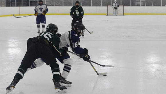 New Rochelle's Nick Scollard (16) attempts to get clear