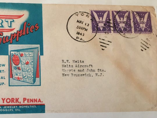"The colorful red and blue return address, which takes up half of the envelope, on the Karl Ort Aviation Supplies envelope postmarked 1943.  Note the three three-cent ""Win The War"" stamps on the envelope."