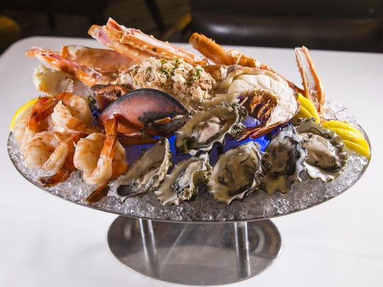 The seafood tower for two at Atlantis Steakhouse in Atlantis Casino Resort Spa features oysters, jumbo prawns, king crab legs, and a half Maine lobster stuffed with Dungeness crab Louis.