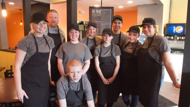 The staff of Go Taco!, which just opened in downtown Pinckney, is ready for business. From left are Hannah Kerns, Chef Eirik Kauserud, owner Bebecca Kauserud, Eirik Kauserud Jr., Savannah Soronen, Lilly Hovorka, Zach Wondolkowski, Madison Walz and Olivia Ingram.