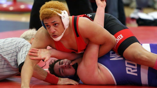 Sleepy Hollow's Derek Esrella pins New Rochelle's Aidan Lilly in the 195-pound weight class of the Division 1 wrestling sectional qualifier championship round at Sleepy Hollow High School Feb. 6, 2016