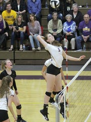 Lexington's Natalie Beer goes high for a spike in Saturday's Division II regional championship volleyball match against Padua.