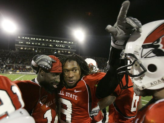 In this Nov. 25, 2008, file photo, Ball State linebacker Wendell Brown, left, stands with cornerback Trey Buice near the end of an NCAA college football game in Muncie, Ind.