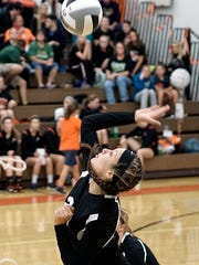 Lucas' Kexi Barnett goes for a spike during their game