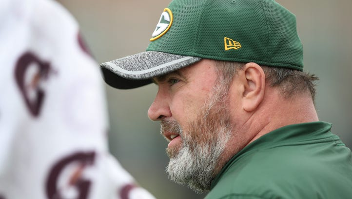 Green Bay Packers coach Mike McCarthy watches during