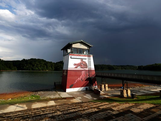 In this Tuesday, July 19, 2016 photo, the tower at Lake Lanier Olympic Park, home of the 1996 Summer Olympic Games rowing events, stands after being renovated in Gainesville, Ga. This man-made lake still has its rowing facilities, which have been used for major competitions over the last two decades. This year, it hosted an Olympic qualifier for Rio and will host the Dragon Boat World Championships in 2018. (AP Photo/David Goldman)