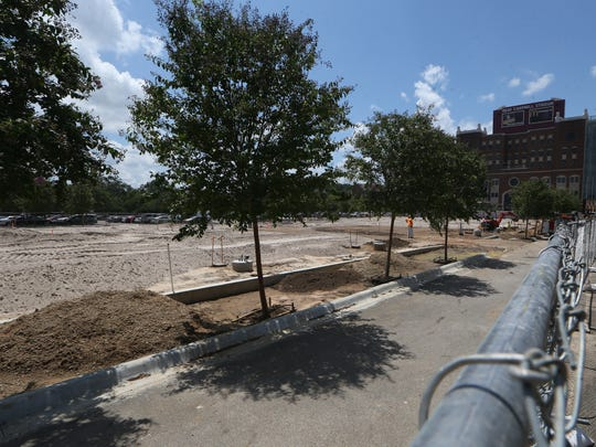 FSU's Langford green near Doak Campbell Stadium where construction is underway to replace the brick and sod.