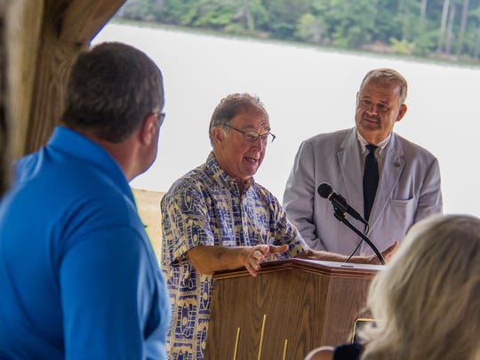 Ed McAlister (left), owner of River Sports Outfitters, and Lenoir City Mayor Tony Aikens address a small crowd Thursday at Lenoir City Park about their plan to bring kayak and paddleboard rentals to the park within the next month.