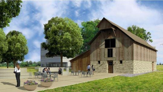 A rendering shows Woodward's concept to restore the historic Coy-Hoffman Barn on its corporate campus in Fort Collins and repurpose two concrete silos as seating areas on their original footprints.