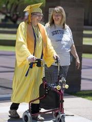 Gwendolyn Carlson, 84, walks with her Scottsdale Community