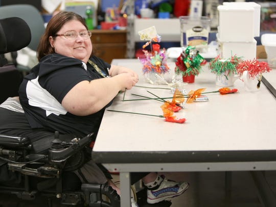 Stacy Whipp, who was born with spina bifida, currently works at Production Services Unlimited in Lebanon. It's a non-profit business owned by the Warren County Board of Developmental Disabilities.