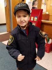 Nine-year-old Ithaca Police Department Officer Colin