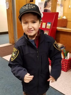 Nine-year-old Ithaca Police Department Officer Colin Hayward Toland.