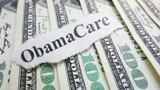 Obamacare newspaper headline on cash