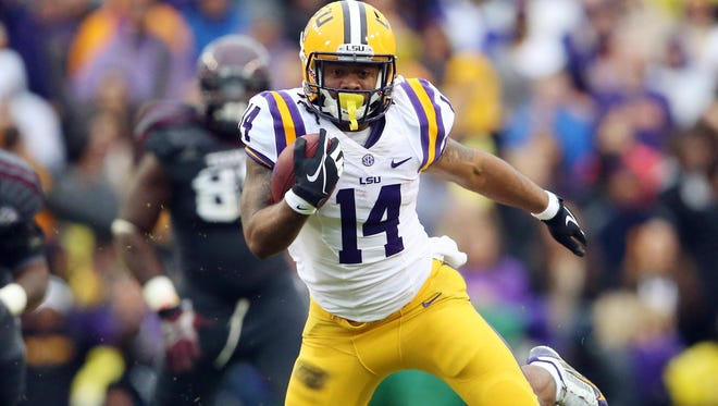 LSU running back Terrence Magee carries the ball against Texas A&M defense during the Tigers' defeat of the Aggies.