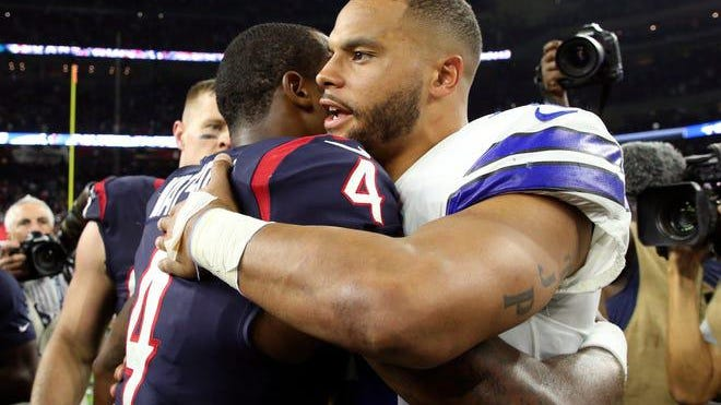 Dallas Cowboys quarterback Dak Prescott, right, and Houston Texans quarterback Deshaun Watson hug after a game last season at NRG Stadium.