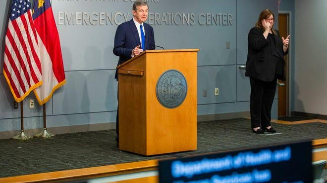 North Carolina Gov. Roy Cooper answers questions at a recent press conference in Raleigh.