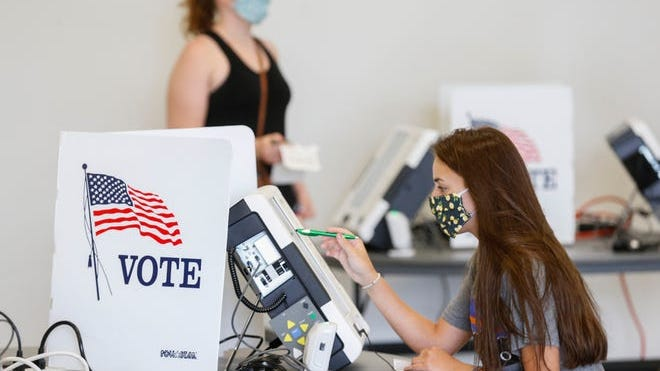 Voters cast their ballots at Missouri State University during the primary election on Tuesday, Aug. 4, 2020.