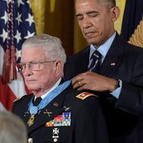 President Barack Obama presents the Medal of Honor to retired Army Lt. Col. Charles Kettles of Michigan during a ceremony in the East Room of the White House in Washington, Monday, July 18, 2016. Kettles distinguished himself in combat operations near Duc Pho, Vietnam, and is credited with saving the lives of 40 soldiers and four of his own crew members. (AP Photo/Susan Walsh)