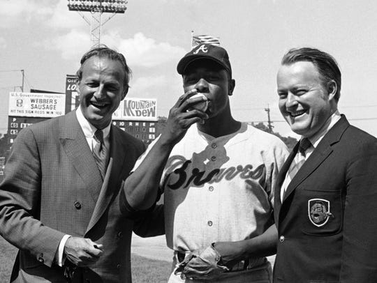 Atlanta's Hank Aaron, center, became the ninth player