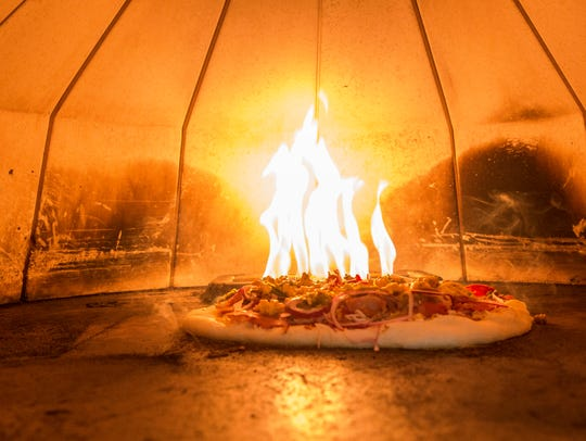 Executive Chef Matt Burns cooks up pizzas at Elm Street
