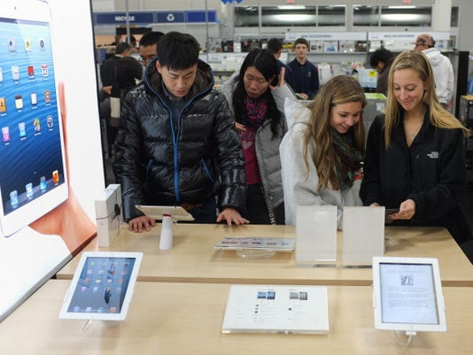 Apple at 2013 high on China Mobile, holiday hopes