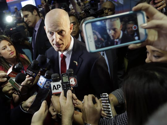 Florida Gov. Rick Scott speaks in the spin room before