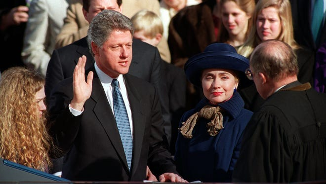 """William Jefferson """"Bill"""" Clinton, with his wife Hillary Rodham Clinton and daughter Chelsea at his side, takes the oath of office as 42nd president of the United States from Chief Justice William H. Rehnquist on the west steps of the Capitol in Washington Wednesday, Jan. 20, 1993. (AP Photo/Ed Reinke)"""