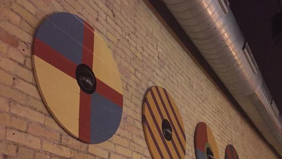 Artwork representing Viking shields hangs on the wall