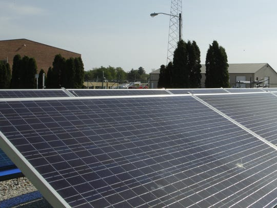 Solar panels generate power at the office of Tipmont REMC on April 26, 2017, in Linden.