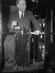 Sen. Burton Wheeler sits at the controls of the U.S.