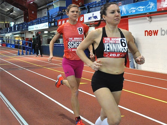 Scarsdale's Lindsey Scherf (l) and Ireland's Caitriona Jennings early in the indoor marathon at the Armory. Scherf broke the women's world indoor marathon record.