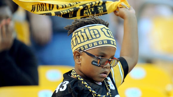 A young Pittsburgh Steelers fan twirls his Terrible Towel at the start of the NFL preseason football game between the Pittsburgh Steelers and the Carolina Panthers on Thursday.