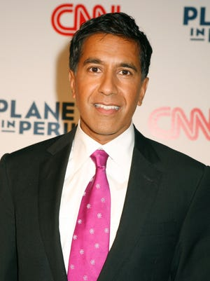 """In this Oct. 8, 2007 file photo, Dr. Sanjay Gupta attends a screening of the environmental documentary """"Planet in Peril,"""" in New York."""