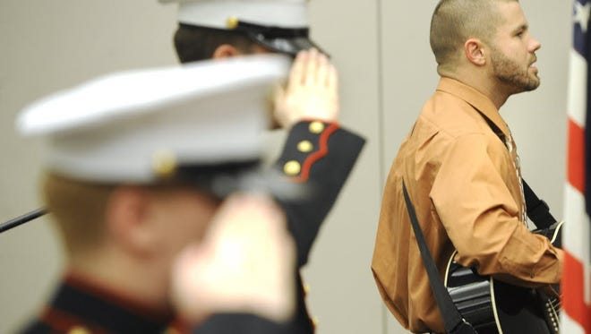In this 2013 photo, Matt Plever, right, and members of the Dallastown HS JROTC rehearse before the start of the York County Veterans Treatment Court celebration.