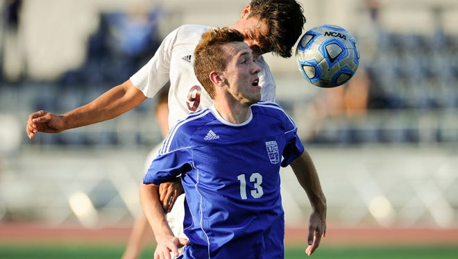 Chesterton's Matt Blake (9) heads the ball past Memorial's Andrew Cross (13) during the Class 2A state championship at Carroll Stadium in Indianapolis, Saturday, Oct. 29, 2016. Memorial beat Chesterton 2-1.
