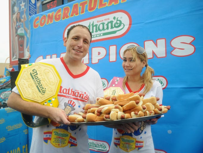 Joey Chestnut won the men's division with 61 hot dogs. Miki Sudo won the women's division with 34 hot dogs at the 2014 Nathan's Famous Fourth of July International Hot Dog Eating Contest at Coney Island on July 4, 2014 in the Brooklyn borough of New York City.