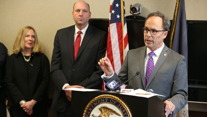 US Attorney William Hochul, Jr., right, talks about the indictment of 14 people as part of a major heroin bust during a press conference at the Keating Federal Building in downtown Rochester Thursday, March 31, 2016.