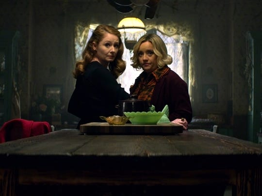 "Miranda Otto as Zelda and Lucy Davis as Hilda on ""Chilling Adventures of Sabrina."""