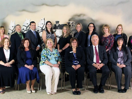 Twenty-five associates earned new designations at Glatfelter Insurance Group. Pictured in the front row, from left, are: Sheri Eckenrode, Laurie Smith, Selina Zuch, Tanya Ferguson, Terri Marshall, Scott Harkins, Peggy Baker, and Joseph Wurtz. Pictured in the second row, from left, are: Emily Donatelli, Jami Paules, Todd Holland, Richard Beyers, Amy Stayrook, Jaime Peters, Holly Kauffman, Jennifer Sultner, Rosalie Harbourt, Lida Horn, and Tina Carpenter. Joshua Klein, Lori Edwards, Gregory Deibel, Justin Nicholas, Lamar Messner and Cheryl Warner were absent for the photo.