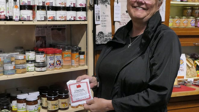 Leslie Mingenback, the manager and buyer of Heart of Kansas Mercantile, shows off some of her store's Kansas-made products.