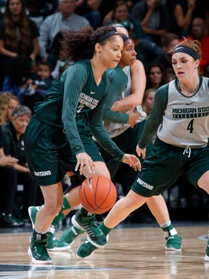 Michigan State's Kalabrya Gondrezick, left, drives against Taryn McCutcheon (4) Friday, Oct. 14, 2016, in East Lansing, Mich.