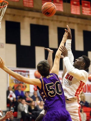 West Oso's Kwamin Huff takes the ball to the basket against Aransas Pass on Tuesday, Feb. 7, 2017, at West Oso High School in Corpus Christi.